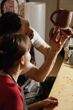 Pottery teacher showing student the jug Royalty Free Stock Photography