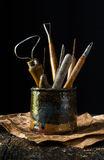 Pottery Tools in Hand Crafted Clay Pot Stock Photos