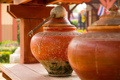 Thai water pot. A pottery used as a water container ,Thai water pot Royalty Free Stock Images
