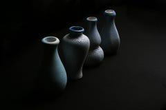 Pottery vase. Four pottery vase on the black background Stock Photo