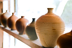 Pottery vases on shelf