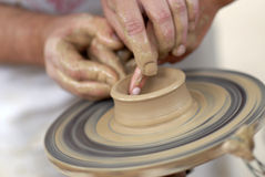 Pottery wheel. Hands working on pottery wheel Stock Photos