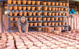 Pottery workers check before selling ceramic products Royalty Free Stock Photo