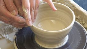 Pottery workshop handmade craft artisan clay wheel. Pottery workshop. handmade craft. artisan shaping a clay bowl on turning potter wheel stock footage