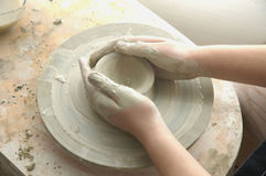 Pottery25. Larning how to make pottery Stock Photo