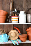 Potting Shed Shelves. Closeup of items on the shelves of a potting shed. The rustic interior is full of flower pots, and other accessories and tools used in Royalty Free Stock Image