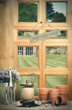 The Potting Shed. With window overlooking garden Royalty Free Stock Images