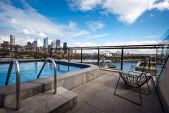 Sydney landmarks admired form above in a relaxing atmosphere. Potts Point, Sydney, Australia - September 03, 2018: Rooftop Swimming Pool in Potts Point on a royalty free stock image