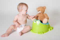 Potty time. Toddler is learning how to use his potty stock images