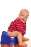 Potty training. Portrait of a baby girl - Potty training stock photography
