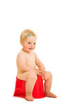 Potty training. Toddler girl potty trainting isolated on white royalty free stock photography