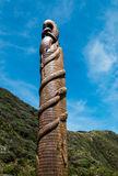Pou Tangaroa. (God and protector of the Sea) on the Pukerua Bay foreshore, New Zealand Royalty Free Stock Photography