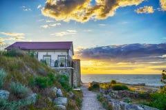 Pouca casa pelo mar Imagem de Stock
