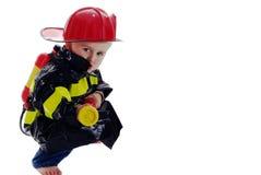 Pouca criança do lutador de incêndio Imagem de Stock