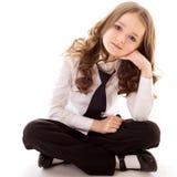 Pouca menina do negócio senta-se Imagem de Stock Royalty Free