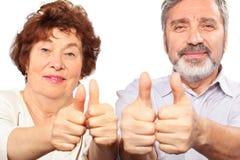 Pouce aîné d'exposition de couples Images libres de droits