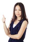 Pouce asiatique de femme  Photos stock
