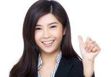 Pouce asiatique de femme d'affaires  Images stock