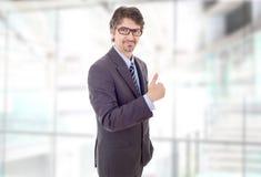 Pouce d'homme d'affaires vers le haut image stock