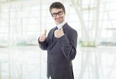 Pouce d'homme d'affaires vers le haut photo stock