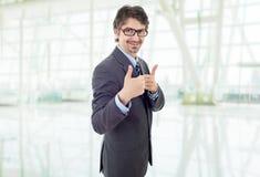 Pouce d'homme d'affaires vers le haut photos stock
