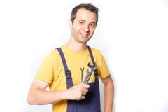 Pouce de mécanicien de travailleur vers le haut de geste d'isolement sur le blanc Images stock