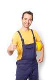 Pouce de mécanicien de travailleur vers le haut de geste d'isolement sur le blanc Image stock