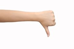 Pouce de signalisation de main vers le bas Photographie stock