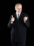 Pouce de sourire vers le haut d'homme d'affaires au téléphone Image stock