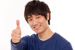 Pouce heureux d'exposition de jeune homme Photo stock