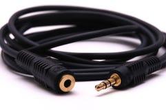 5 pouces à disque souple sur un fond blanc solide mâle de 5mm au câble d'extension audio femelle de prise Images stock