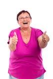 Pouces aînés heureux de femme vers le haut Photos libres de droits