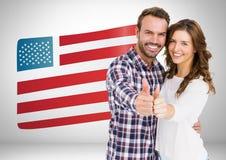Pouces de couples sur le fond de drapeau américain Photographie stock libre de droits
