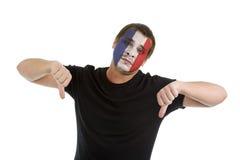 Pouces vers le bas avec l'indicateur français Image libre de droits