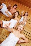 Pouces vers le haut dans un sauna Photographie stock libre de droits