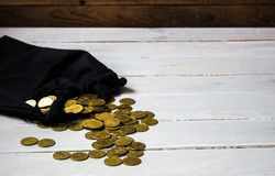 Pouch of gold coins. On wooden background royalty free stock photos