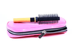 Pouch and hair roller brush Royalty Free Stock Photography
