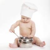 Pouco cozinheiro bonito no fundo branco Fotos de Stock Royalty Free