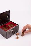 Pouco dinheiro na caixa velha do dinheiro Fotografia de Stock Royalty Free