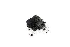 Poudre de charbon actif tirée avec la macro lentille Photos stock
