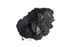 Poudre de charbon actif tirée avec la macro lentille Image libre de droits