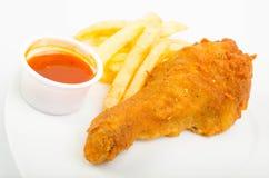 Poulet avec les fritures et la sauce Photo stock