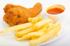 Poulet avec les fritures et la sauce Photographie stock libre de droits