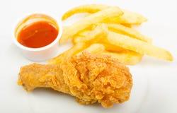 Poulet avec les fritures et la sauce Photo libre de droits