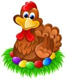 Poulet de Pâques sur des oeufs Photos libres de droits