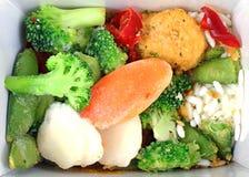 Poulet et légumes oranges figés Photo stock