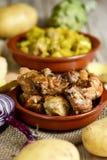 Poulet et lapin rôtis par Espagnol Photos stock
