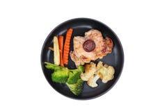 Poulet frit de teriyaki avec la pomme de terre et l'herbe de beurre Images libres de droits