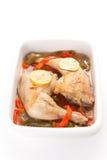 Poulet rôti avec les poivrons rouges et verts Image stock
