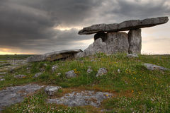 Poulnabrone Dolmen. In cloudy sunset light . Clare county , Ireland Stock Images